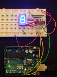 Arduino Uno connected to a 7 segment LCD display through a shift register.